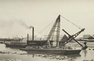 Dredging the river for the Sanitary and Ship Canal