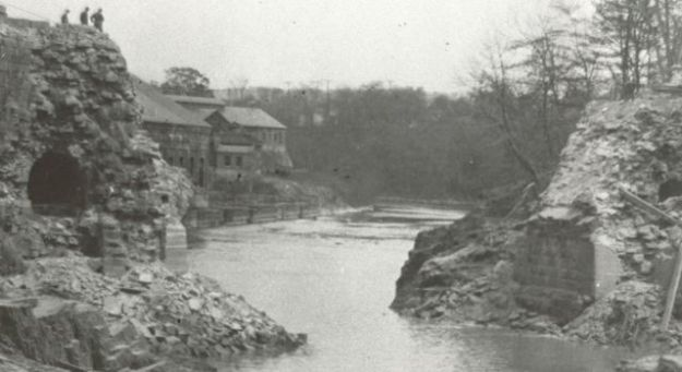 About 1925. The old Morris Canal being destroyed at Little Falls, showing the treatment plant in the background